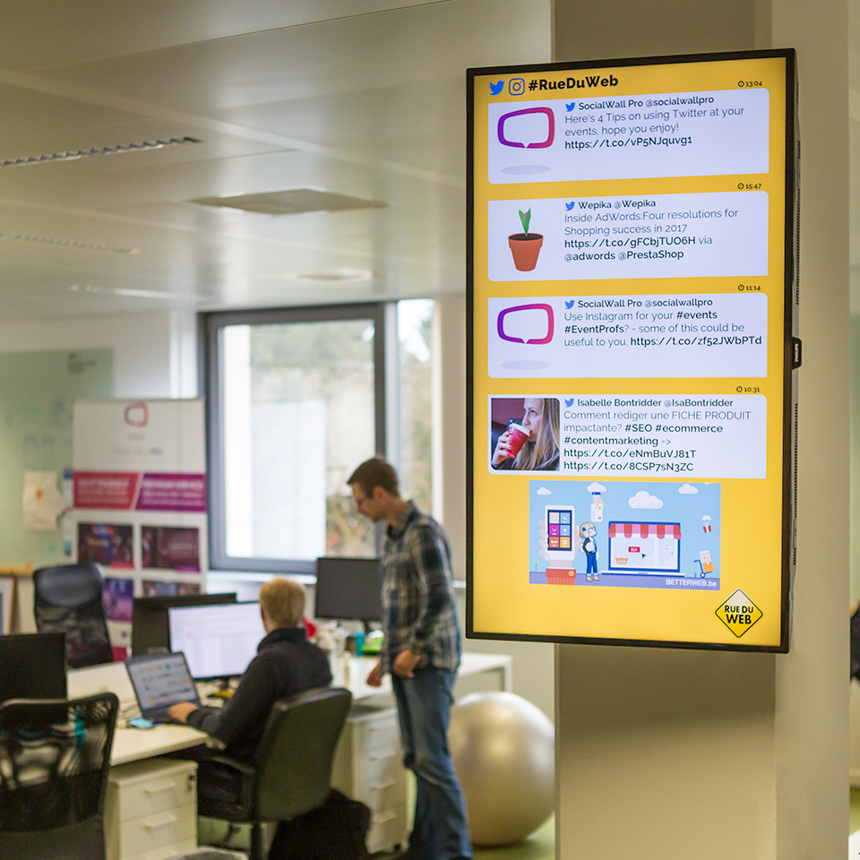social media wall on a screen in workplace